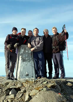 A successful Three Peaks Challenge team on the summit of Ben Nevis